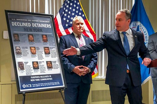 "(AP Photo/Jim Mustian). Matthew Albence, right, the acting director of U.S. Immigration and Customs Enforcement, speaks during a news conference, Friday, Jan. 17, 2020, in New York. The country's top immigration official blamed the ""sanctuary policies""..."