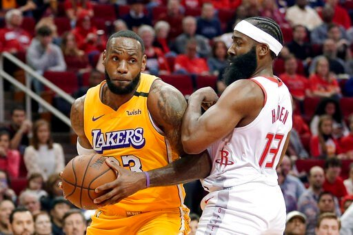 (AP Photo/Michael Wyke). Los Angeles Lakers forward LeBron James (23) bumps Houston Rockets guard James Harden (13) as he drives to the basket during the first half of an NBA basketball game Saturday, Jan. 18, 2020, in Houston.