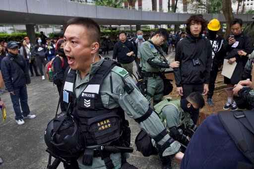 (AP Photo/Ng Han Guan). Riot police perform body search on a man ahead of a rally demanding electoral democracy and call for boycott of the Chinese Communist Party and all businesses seen to support it in Hong Kong, Sunday, Jan. 19, 2020. Hong Kong has...