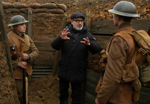 "(François Duhamel/Universal Pictures via AP). This image released by Universal Pictures shows Dean-Charles Chapman, left, director Sam Mendes, center, and George MacKay on the set of ""1917."" On Monday, Jan. 13, Mendes was nominated for an Oscar for bes..."