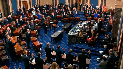 (Senate Television via AP, File). FILE - In this Jan. 16, 2020, image from video, presiding officer Supreme Court Chief Justice John Roberts swears in members of the Senate for the impeachment trial against President Donald Trump at the U.S. Capitol in...