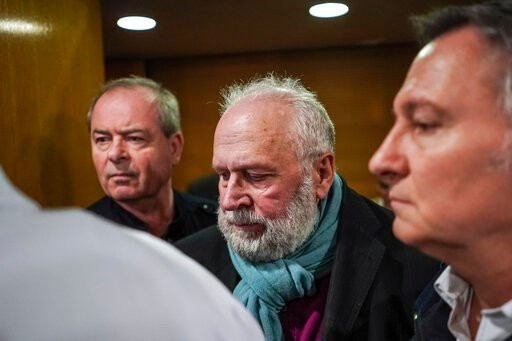 (AP Photo/Laurent Cipriani). Former French priest Bernard Preynat, center, arrives at the Lyon court house, central France, Monday Jan.13, 2020. Bernard Preynat, is accused of sexually abusing some 75 Boy Scouts went on trial Monday _ but the proceedin...