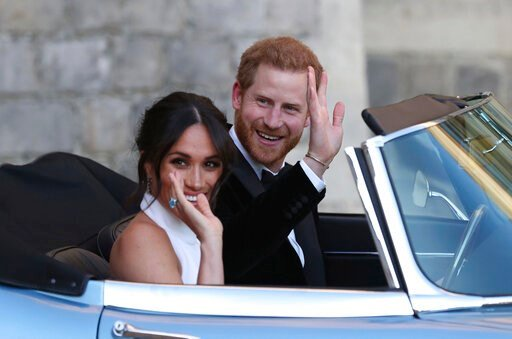 (Steve Parsons/pool photo via AP, File). FILE - In this Saturday, May 19, 2018 file photo the newly married Duke and Duchess of Sussex, Meghan Markle and Prince Harry, leave Windsor Castle in a convertible car after their wedding in Windsor, England, t...