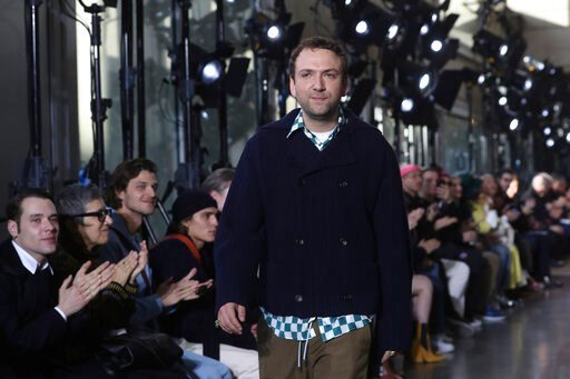 (AP Photo/Thibault Camus). Creative director Bruno Sialelli walks on the stage after the presentation of Lanvin Mens Fall/Winter 2020-2021 fashion collection Sunday, Jan. 19, 2020 in Paris.