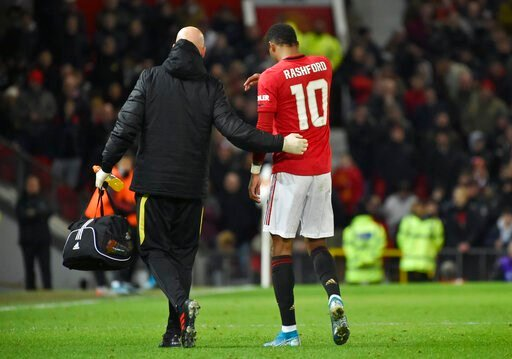 (AP Photo/Rui Vieira). Manchester United's substitute player Marcus Rashford walks off the pitch with an injury during the English FA Cup third round replay soccer match between Manchester United and Wolverhampton Wanderers at Old Trafford in Mancheste...