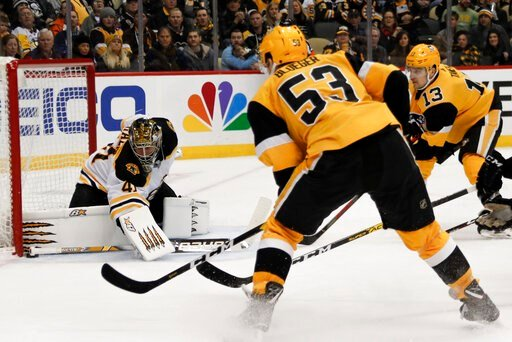 (AP Photo/Keith Srakocic). Boston Bruins goaltender Jaroslav Halak (41) keeps the puck out of the net as Pittsburgh Penguins' Teddy Blueger (53) and Brandon Tanev (13) look for a rebound during the second period of an NHL hockey game, Sunday, Jan. 19, ...