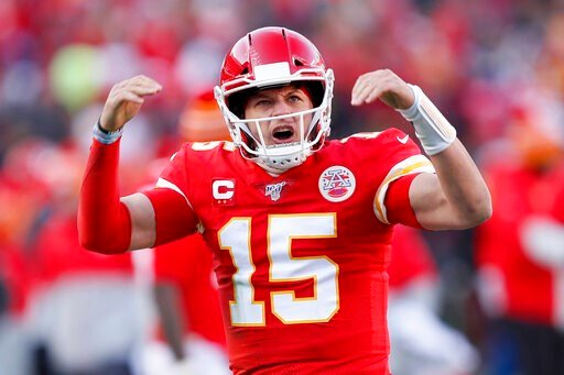 (AP Photo/Charlie Neibergall). Kansas City Chiefs' Patrick Mahomes reacts after throwing a touchdown pass to Tyreek Hill during the first half of the NFL AFC Championship football game against the Tennessee Titans Sunday, Jan. 19, 2020, in Kansas City,...