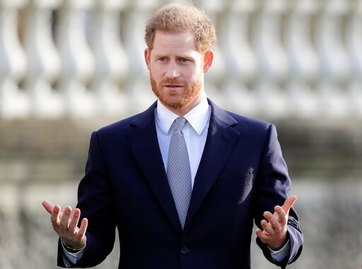 (AP Photo/Kirsty Wigglesworth). Britain's Prince Harry gestures in the gardens of Buckingham Palace in London, Thursday, Jan. 16, 2020. Prince Harry, the Duke of Sussex will host the Rugby League World Cup 2021 draw at Buckingham Palace, prior to the d...