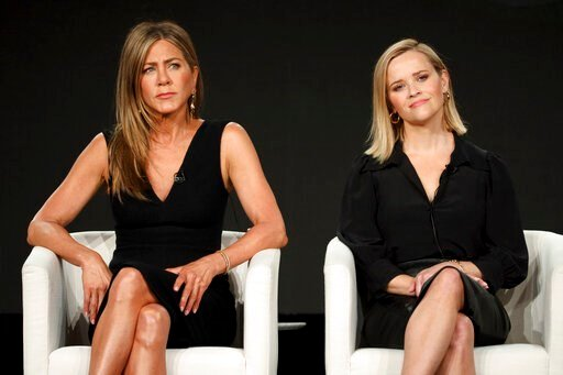"(Photo by Willy Sanjuan/Invision/AP). Jennifer Aniston, left, and Reese Witherspoon speak at ""The Morning Show,"" panel during the Apple+ TCA 2020 Winter Press Tour at the Langham Huntington, Sunday, Jan. 19, 2020, in Pasadena, Calif."