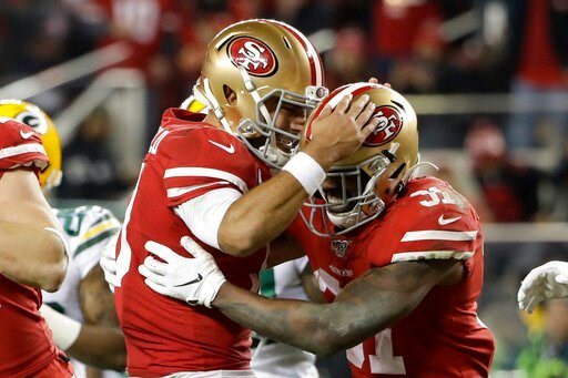 (AP Photo/Marcio Jose Sanchez). San Francisco 49ers running back Raheem Mostert, right, celebrates his touchdown with quarterback Jimmy Garoppolo during the second half of the NFL NFC Championship football game against the Green Bay Packers Sunday, Jan...