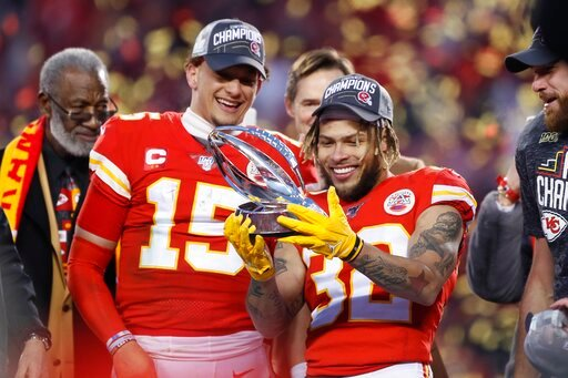 (AP Photo/Charlie Neibergall). Kansas City Chiefs' Tyrann Mathieu and Patrick Mahomes (15) hold up the Lamar Hunt Trophy after the NFL AFC Championship football game against the Tennessee Titans Sunday, Jan. 19, 2020, in Kansas City, MO. The Chiefs won...