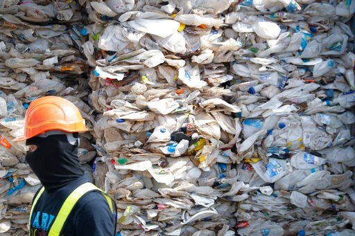 (AP Photo/Vincent Thian, File). FILE - In this May 28, 2019, file photo, a container is filled with plastic waste from Australia, in Port Klang, Malaysia. Malaysia has sent back 150 containers of plastic waste to 13 mainly rich countries since the thir...