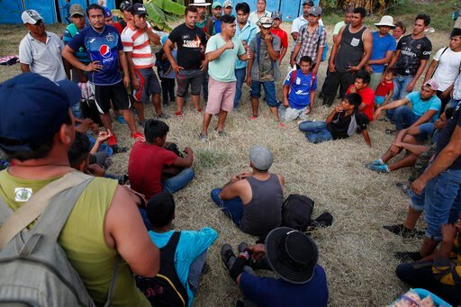 (AP Photo/Moises Castillo). Honduran migrants gather at a temporary shelter in Tecun Uman, Guatemala, on the border with Mexico, Sunday, Jan. 19, 2020. More than 2,000 migrants spent the night in Tecun Uman on the Guatemalan side of the border, uncerta...