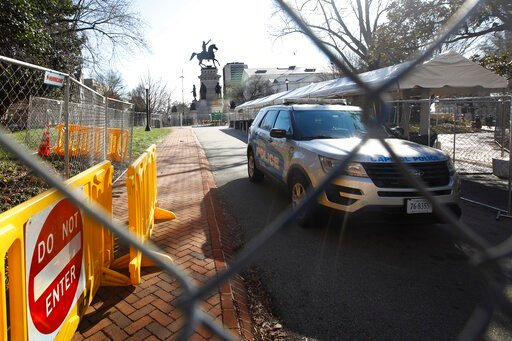 (AP Photo/Steve Helber). Fencing and magnetometers are set up around Capitol Square for the anticipated pro-gun rally Sunday, Jan. 19, 2020, in Richmond, Va.