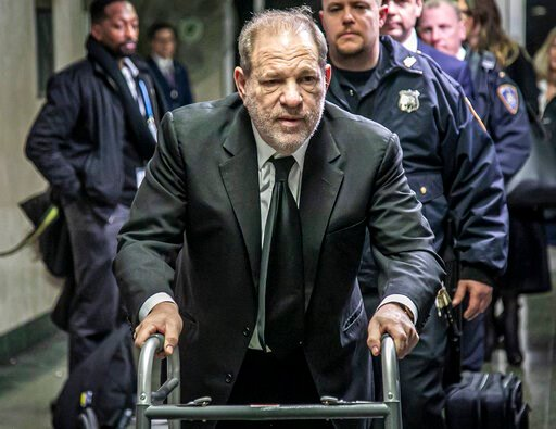 (AP Photo/Bebeto Matthews). Harvey Weinstein leaves a Manhattan courthouse after a second day of jury selection for his trial on rape and sexual assault charges, Thursday, Jan. 16, 2020, in New York.