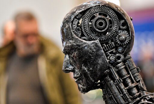 (AP Photo/Martin Meissner, File). FILE - In this Nov. 29, 2019, file photo, a metal head made of motor parts symbolizes artificial intelligence, or AI, at the Essen Motor Show for tuning and motorsports in Essen, Germany. The Trump administration is pr...