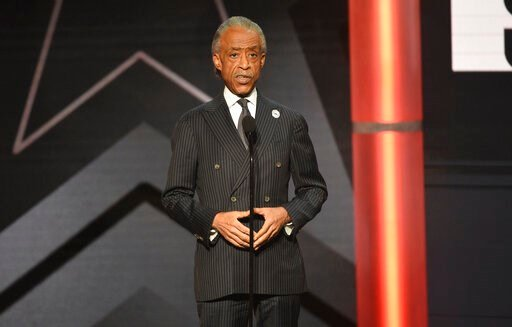 (Photo by Chris Pizzello/Invision/AP, File). FILE - This June 23, 2019 file photo shows Al Sharpton presenting an award at the BET Awards in Los Angeles. Sharpton is working on a book meant to address what he calls an urgent moment in American history....