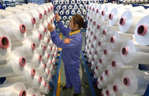 (Chinatopix via AP). An employee works in a chemical fiber plant in Nantong in eastern China's Jiangsu Province, Friday, Jan. 17, 2020. China's economic growth sank to a new multi-decade low in 2019 as Beijing fought a tariff war with Washington, but f...