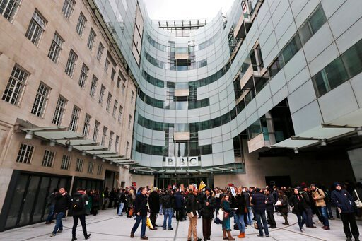 (AP Photo/Lefteris Pitarakis, file). FILE - In this Thursday, March 28, 2013 file photo, BBC journalists and technical staff on strike form a picket line outside BBC's New Broadcasting House in central London. BBC Director-General Tony Hall announced M...