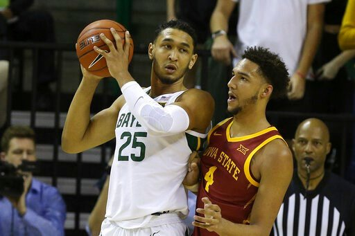 (AP Photo/Jerry Larson). Baylor forward Tristan Clark (25) is guarded by Iowa State forward George Conditt IV (4) during the second half half of an NCAA college basketball game Wednesday Jan. 15, 2020, in Waco, Texas.