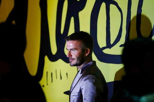 (AP Photo/Brynn Anderson). David Beckham poses for a photograph before a Christian Dior pre-fall 2020 men's fashion collection presentation during Art Basel on Tuesday, Dec. 3, 2019, in Miami.