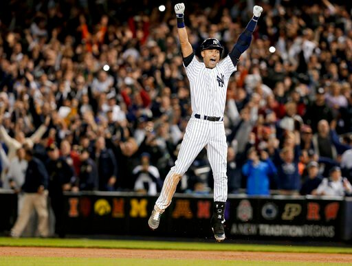 (AP Photo/Julie Jacobson, File). FILE - In this Sept. 25, 2014, file photo, New York Yankees' Derek Jeter jumps after hitting the game-winning single against the Baltimore Orioles in the ninth inning of a baseball game, in New York. Jeter is among 18 n...