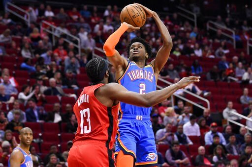 (AP Photo/Eric Christian Smith). Oklahoma City Thunder guard Shai Gilgeous-Alexander (2) shoots over Houston Rockets guard James Harden (13) during the first half of an NBA basketball game, Monday, Jan. 20, 2020, in Houston.
