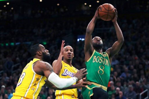 (AP Photo/Charles Krupa). Boston Celtics guard Kemba Walker (8) drives to the basket past Los Angeles Lakers guard Avery Bradley (11) and forward LeBron James (23) during the first half of an NBA basketball game in Boston, Monday, Jan. 20, 2020.