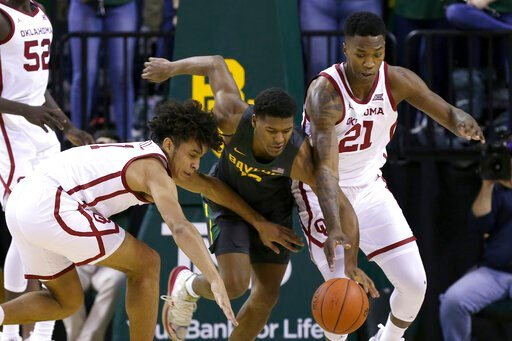 (AP photo/ Jerry Larson). Oklahoma forward Jalen Hill (1) Baylor guard Jared Butler (12) and Oklahoma forward Kristian Doolittle (21) reach for the loose ball in the first half of an NCAA college basketball game Monday, Jan. 20, 2020, in Waco, Texas.