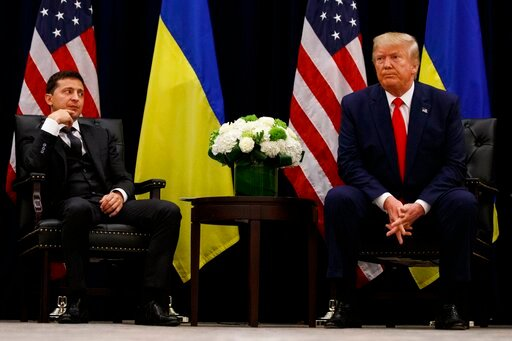 (AP Photo/Evan Vucci, File). FILE - In this Sept. 25, 2019, file photo, President Donald Trump meets with Ukrainian President Volodymyr Zelenskiy at the InterContinental Barclay New York hotel during the United Nations General Assembly, in New York. It...