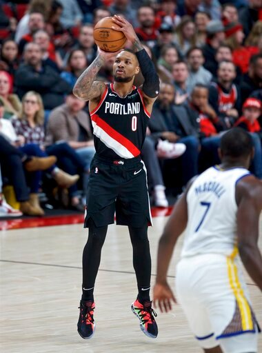 (AP Photo/Craig Mitchelldyer). Portland Trail Blazers guard Damian Lillard shoots a 3-point basket against the Golden State Warriors during the second half of an NBA basketball game in Portland, Ore., Monday, Jan. 20, 2020.
