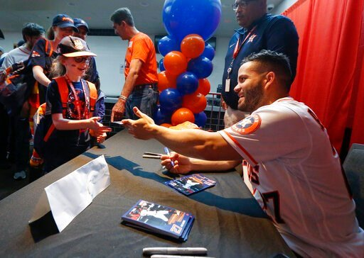 (Steve Gonzales/Houston Chronicle via AP). Jose Altuve signs autographs for young fans during the baseball team's FanFest at Minute Maid Park on Saturday, Jan. 18, 2020, in Houston.