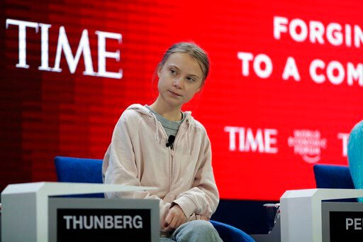 (AP Photo/Markus Schreiber). Swedish environmental activist Greta Thunberg takes her seat prior to the opening session of the World Economic Forum in Davos, Switzerland, Tuesday, Jan. 21, 2020. The 50th annual meeting of the forum will take place in Da...