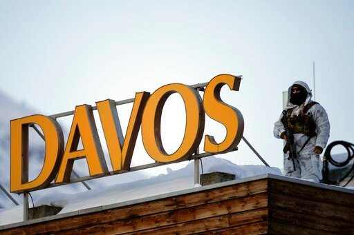 (AP Photo/Markus Schreiber). A police security guard patrols on the roof of a hotel ahead of the World Economic Forum in Davos, Switzerland, Monday, Jan. 20, 2020. The 50th annual meeting of the forum will take place in Davos from Jan. 21 until Jan. 24...