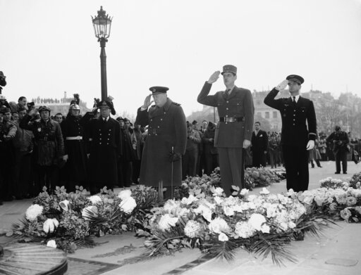 (AP Photo, File). FILE - In this Nov. 12, 1944 file photo, Britain's Prime Minister Winston Churchill, left, and General Charles De Gaulle, centre, salute at France's Unknown Warrior at the Arc De Triomphe in Paris. Though allies in World War II, De Ga...