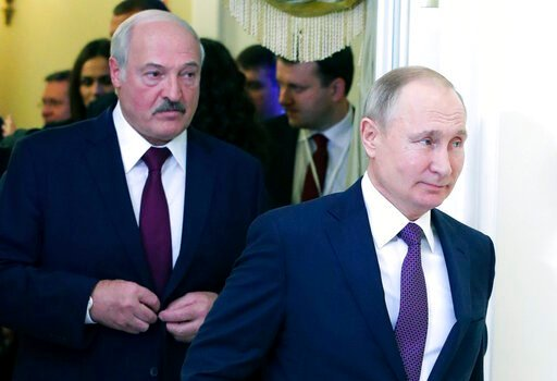 (Mikhail Klimentyev, Sputnik, Kremlin Pool Photo via AP, File). FILE In this file photo taken on Friday, Dec. 20, 2019, Russian President Vladimir Putin, right, and Belarusian President Alexander Lukashenko walk before a meeting of the Supreme Eurasian...