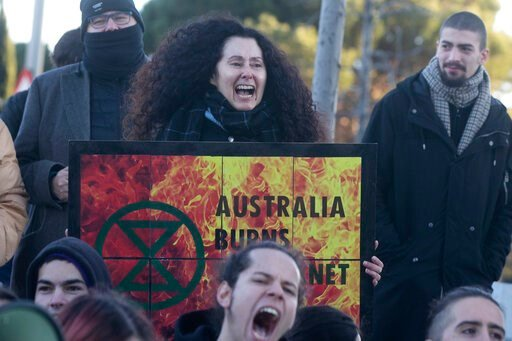 (AP Photo/Paul White). People from the Fridays For Future movement protest outside the Australian Embassy in Madrid, Spain, Friday, Jan.10, 2020. The protest is to demand more climate action and to show solidarity with the critical situation in Austral...