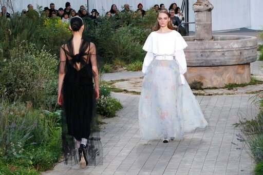 (AP Photo/Francois Mori). Models wear creations for the Chanel Haute Couture Spring/Summer 2020 fashion collection presented Tuesday Jan. 21, 2020 in Paris.