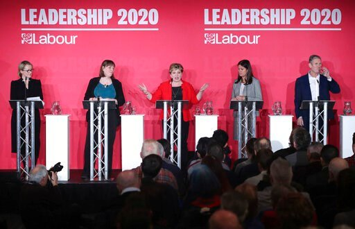 (Danny Lawson/PA via AP). From left, Labour Members of Parliament, Rebecca Long-Bailey, Jess Phillips, Emily Thornberry, Lisa Nandy and Keir Starmer stand on the stage, during the first Labour leadership hustings at the ACC Liverpool, in Liverpool, Eng...