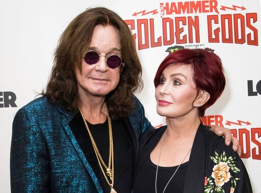 (Photo by Vianney Le Caer/Invision/AP, File). FILE - This June 11, 2018 file photo shows musician Ozzy Osbourne, left, and his wife Sharon Osbourne at the Metal Hammer Golden God awards in London. The 71-year-old Grammy winner and former vocalist for t...