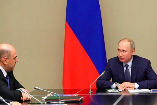 (Mikhail Klimentyev, Sputnik, Kremlin Pool Photo via AP). Russian President Vladimir Putin, right, and New Russian Prime Minister Mikhail Mishustin attend a Security Council meeting at the Novo-Ogaryovo residence outside Moscow in Moscow, Russia, Monda...