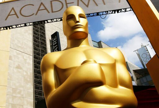 (Photo by Matt Sayles/Invision/AP, File). FILE - In this Feb. 21, 2015 file photo, an Oscar statue appears outside the Dolby Theatre for the 87th Academy Awards in Los Angeles. The winners of last year's acting Academy Awards will return to the Oscar s...