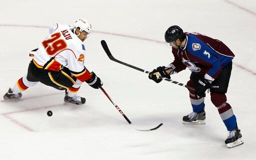 (AP Photo/David Zalubowski, File). FILE - In this Feb. 28, 2013, file photo, Calgary Flames right wing Akim Aliu loses control of the puck as the blade of his stick breaks off, while Colorado Avalanche's Ryan O'Byrne defends during the first period of ...