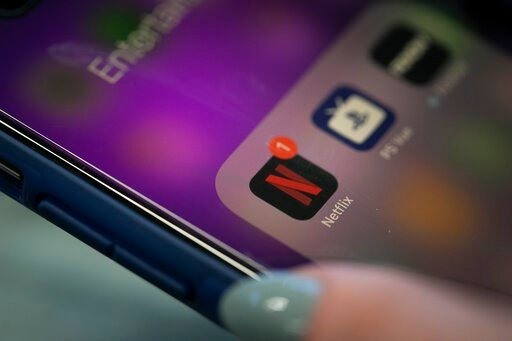 (AP Photo/Jenny Kane, File). FILE - This Oct. 8, 2019, file photo shows the Netflix app on an iPhone in New York. Netflix reports financial results Tuesday, Jan. 21, 2020.