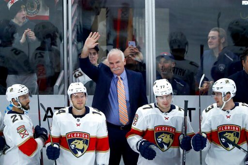 (AP Photo/Charles Rex Arbogast). Florida Panthers head coach and former Chicago Blackhawks coach, Joel Quenneville acknowledges the crowds applause during the first period of an NHL hockey game between the Blackhawks and Panthers, marking Quenneville's...