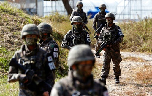 (AP Photo/Lee Jin-man, File). FILE- In this Oct. 13, 2015, file photo, South Korean Army soldiers patrol during the demonstration of search operation at a training field near the demilitarized zone (DMZ) in Cheorwon, South Korea. In the first such case...