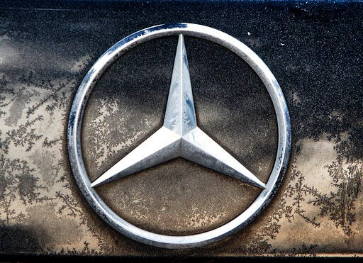(AP Photo/Michael Probst, file). FILE - In this Wednesday, Feb. 6, 2019 file photo the logo of Daimler is photographed on a car in Frankfurt, Germany, Wednesday, Feb. 6, 2019. The maker of Mercedes-Benz luxury cars says its earnings fell by about half ...