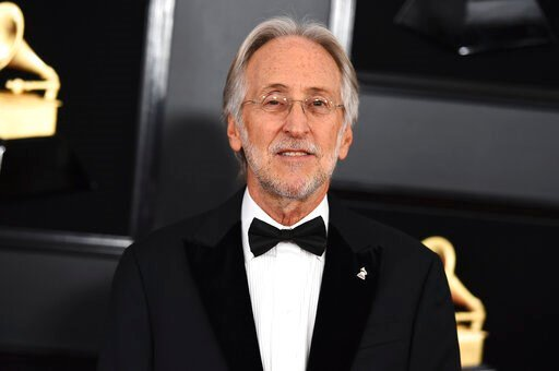 (Photo by Jordan Strauss/Invision/AP, File). FILE - This Feb. 10, 2019 file photo shows then President and CEO of The Recording Academy Neil Portnow at the 61st annual Grammy Awards in Los Angeles. Portnow says a rape allegation against him aired in a ...