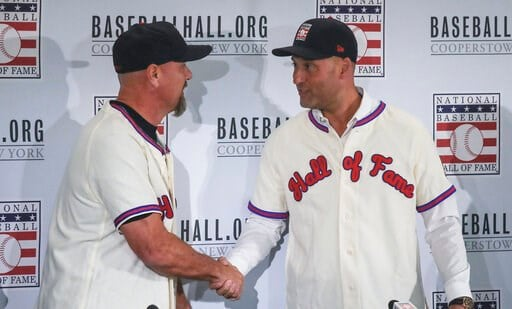 (AP Photo/Bebeto Matthews). Colorado Rockies outfielder Larry Walker, left, and New York Yankees shortstop Derek Jeter shake hands after receiving their Baseball Hall of Fame jersey and cap, Wednesday Jan. 22, 2020, during a news conference in New York.