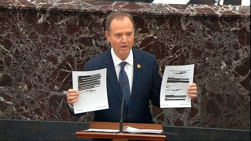 (Senate Television via AP). In this image from video, House impeachment manager Rep. Adam Schiff, D-Calif., holds redacted documents as he speaks during the impeachment trial against President Donald Trump in the Senate at the U.S. Capitol in Washingto...